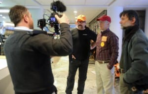 a camera man interviews some of the Vermonters supporting their rights, after they stepped outside the main event.